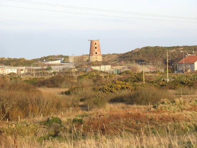 View across waste land towards Melin y Borth
