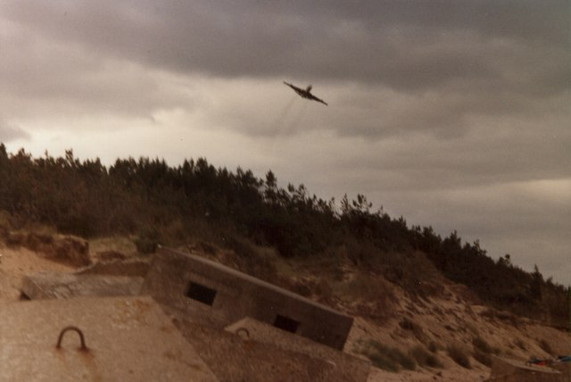 An RAF Nimrod taking off over Roseisle Beach