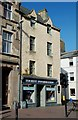 Located in The Sandgate, this is one of the oldest buildings in Ayr and is believed to date from the early 17th century.  The house was restored by the Scottish Historic Buildings Trust in 1991 and the ground floor is now occupied by the tourist information office.  John Loudon McAdam, the famous road-maker, was born here in 1756. (Source: &quot;Ayrshire: Discovering A County&quot;, by Dane Love).