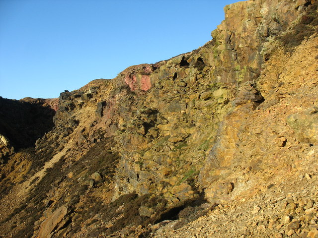 Red coloured rock in the north wall of the eastern open cast working
