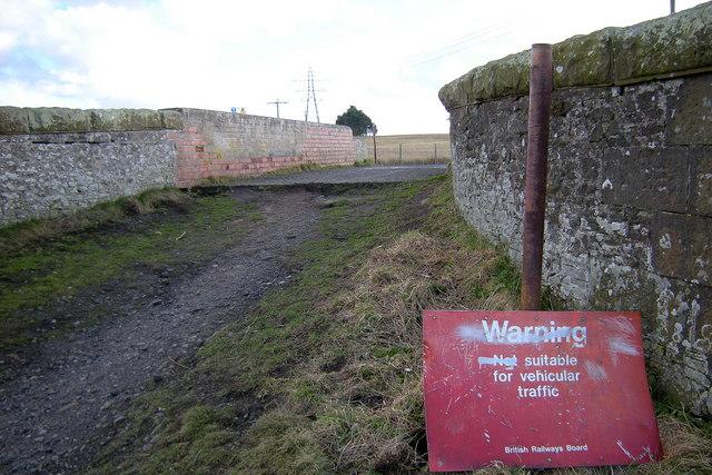 Sign on Railway Bridge east of North Whitehills, Forfar