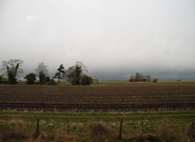 Grey skies, brown fields at Stonea Farm