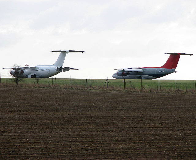 Parked on the edge of the airfield