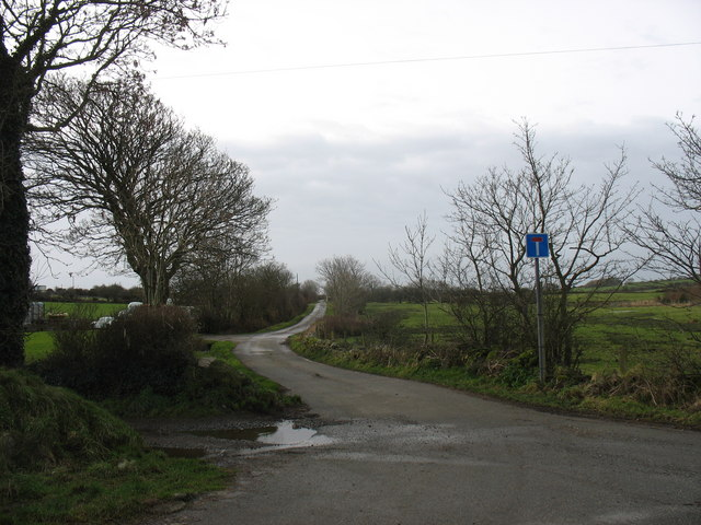 An access no-through road westwards from the junction at Pensarn bridge