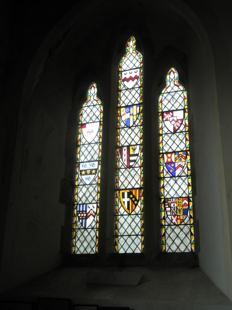 Stained glass window near the font at St John the Evangelist, West Meon