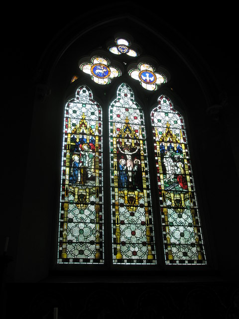 Stained glass windows above the altar at St John the Evangelist, West Meon