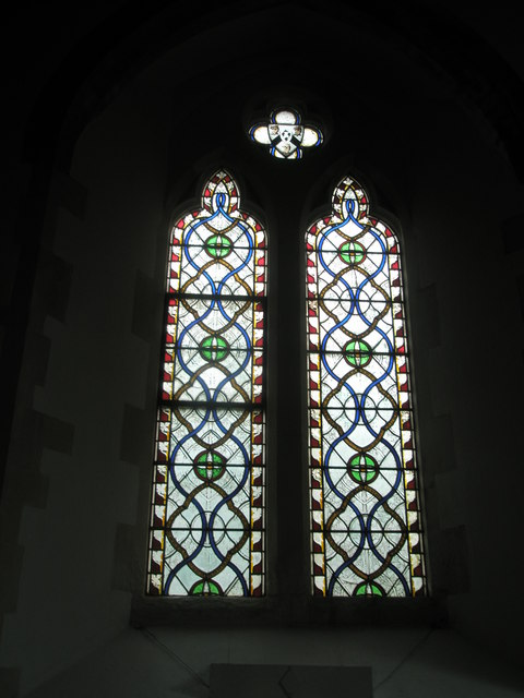 Stained glass window to the west of the side altar at St John the Evangelist, West Meon