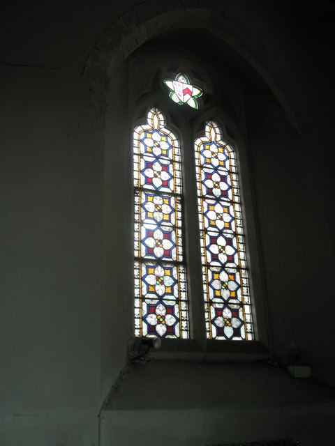Stained glass window in the chancel at St John the Evangelist, West Meon