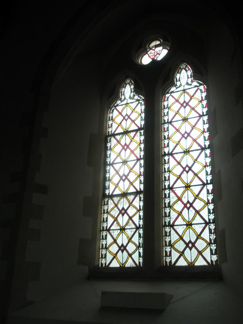 Stained glass window near the War Memorial at St John the Evangelist, West Meon