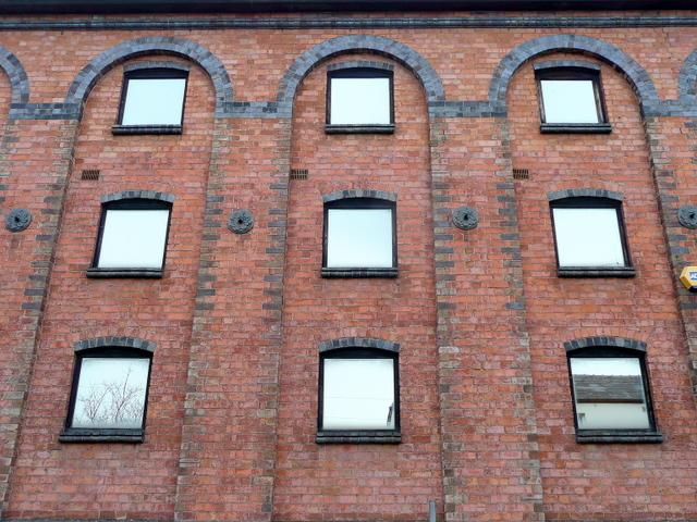 Mirrored windows of The Maltings