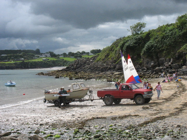 Preparing to launch a motor boat at high water at Traeth Bychan