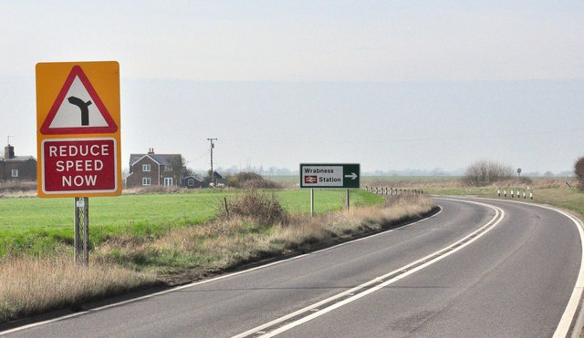 The sign for Wrabness Station, A120