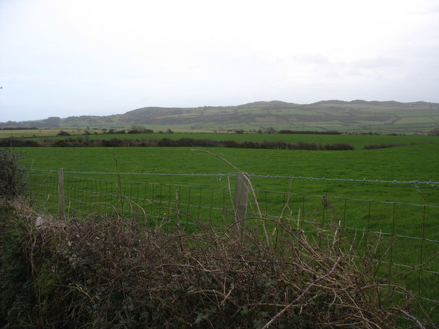 View southeastwards across grazing land towards Mynydd Bodafon mountain