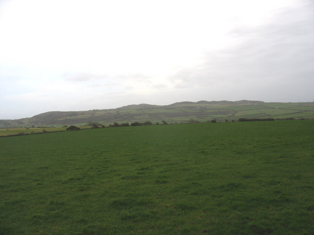 Large open fields extending south of the Llaneuddog road