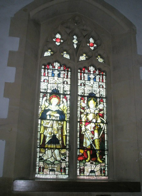 Stained glass window near the font at Holy Trinity, Blendworth