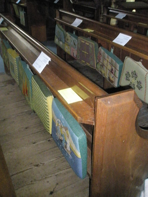 Kneelers and pews within Holy Trinity, Blendworth