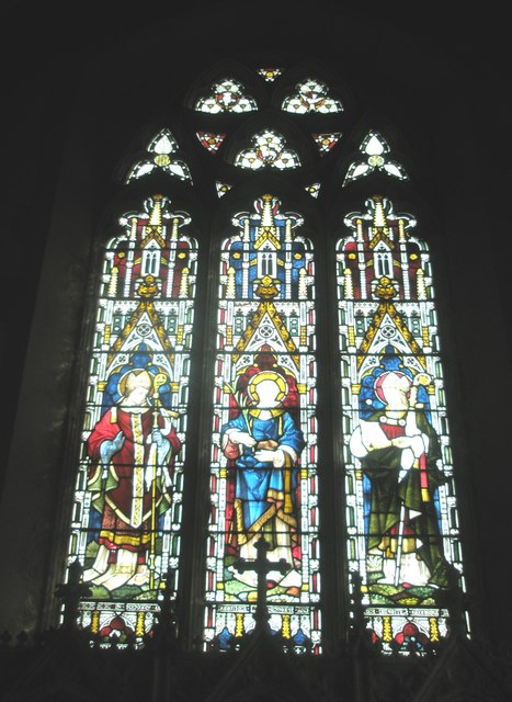 Stained glass windows above the altar at Holy Trinity, Blendworth