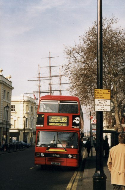 A first glimpse of the masts of the Cutty Sark above the local bus