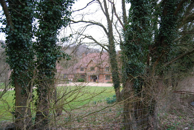 Large house through the trees by the Hangers Way
