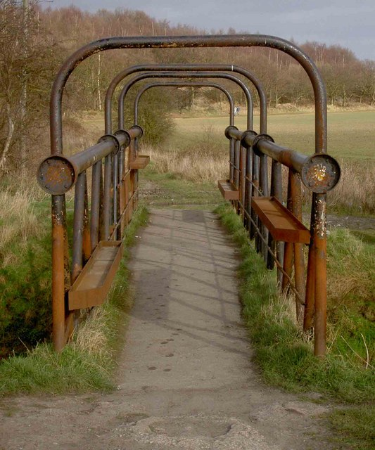 Rusty footbridge over the River Torne