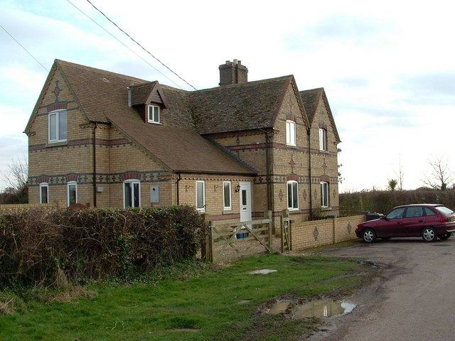Greatly extended farm cottages, Grafham