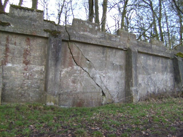 Wall of disused reservoir