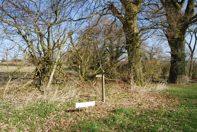 Signpost in the corner of a field