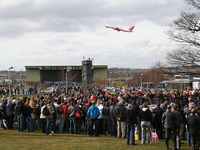 A crowd watches a stunt rider at Ingliston