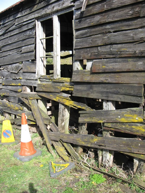 Broken Weather Boarding on Derelict Farm Barn