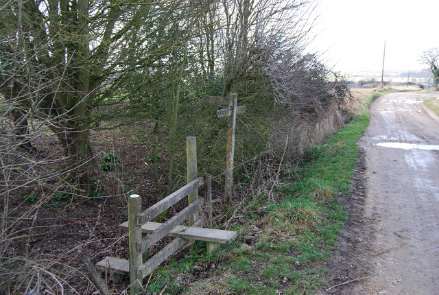 Stile at a track, footpath junction