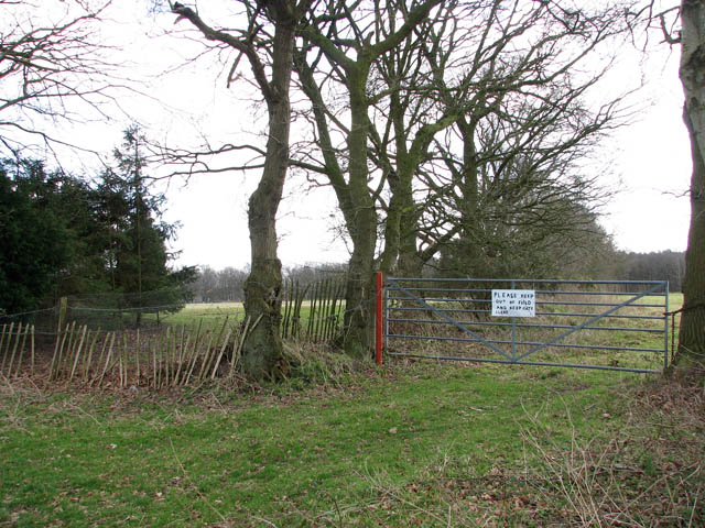 Field gate with a sign