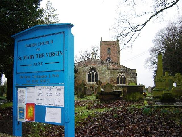 Alne  Parish  Church  with  name  board