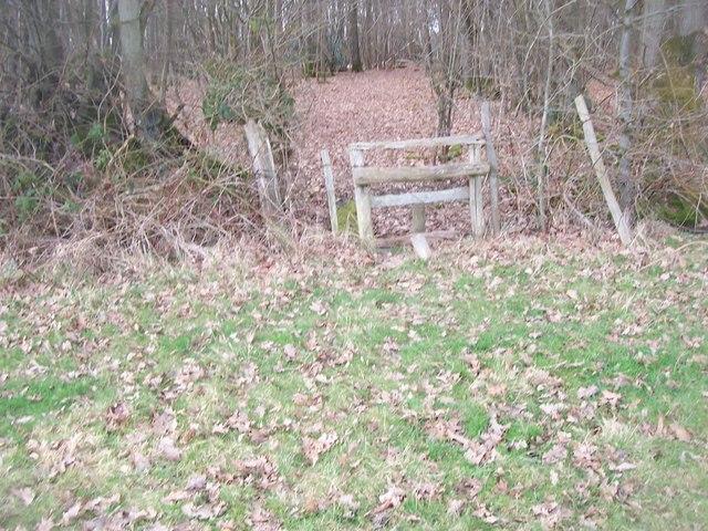 Stile on footpath junction near Acorn Wood