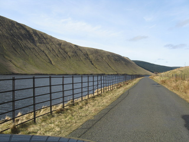 Between the hills and the water, the road goes along Talla side