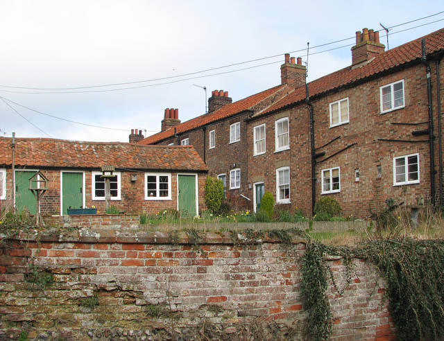 A row of terraced Victorian cottages