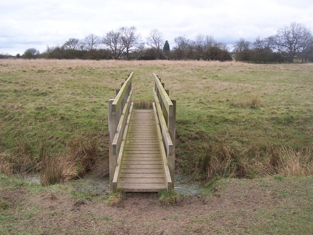 Footbridge in field