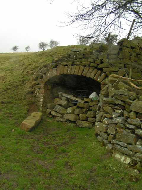 Opening within field wall near Middlesmoor boundary sign