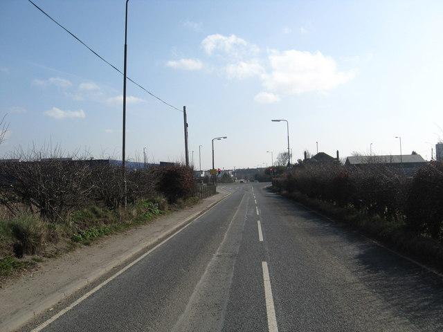 The minor road from Old Pentland nearing its junction with the A701