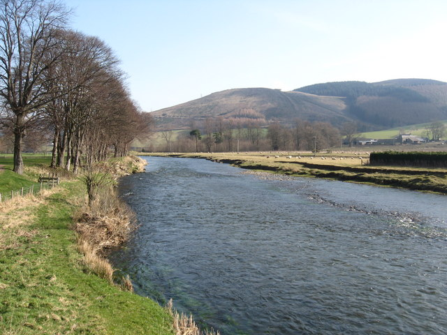 The River Tweed flowing through the Peeblesshire countryside