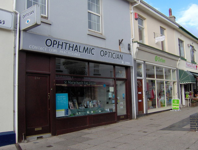 Optician, and charity shop, St Marychurch precinct