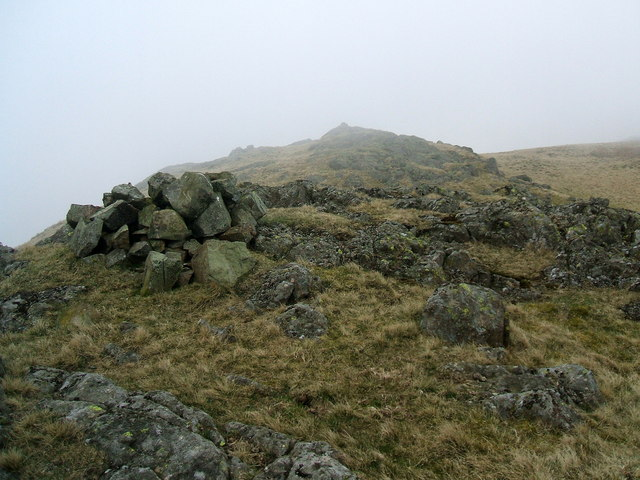 Cairns in the mist on The Knott