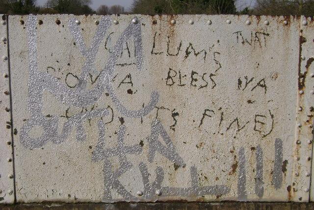 Railway bridge parapet palimpsest