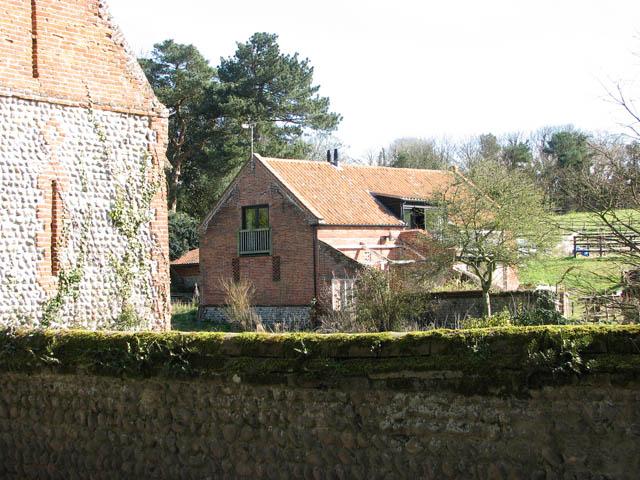 A converted flint and brick barn
