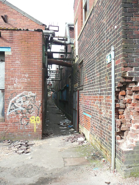 Footpath through the derelict factory, Miry Lane, Hightown, Liversedge
