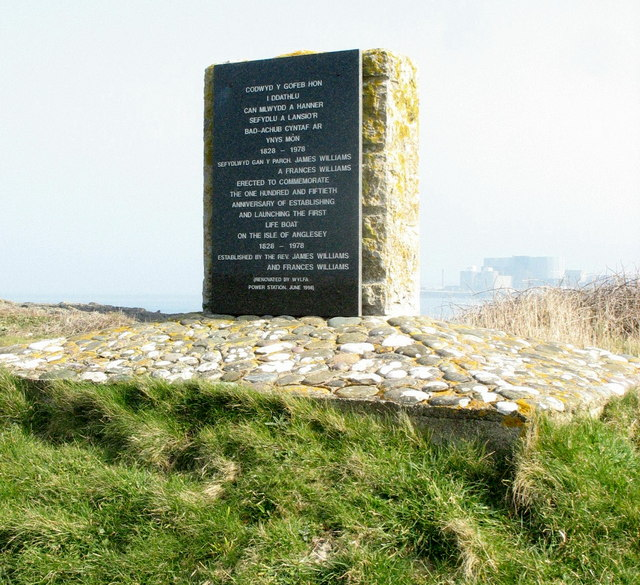 Stone memorial to the establishment of the Cemlyn lifeboat service in 1828