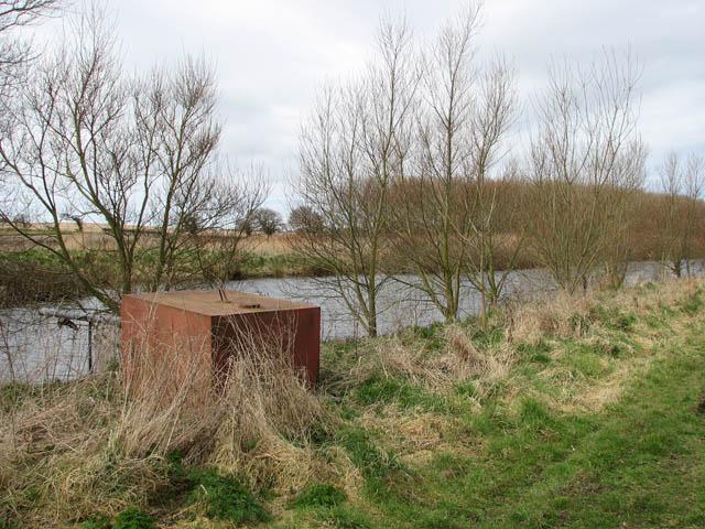 Farm track past reservoir