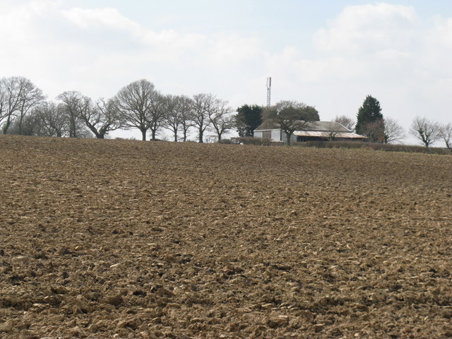 Communication mast behind barn