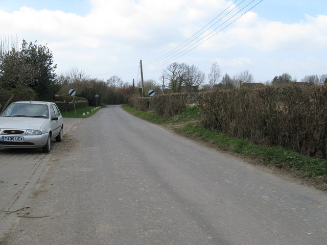 View west along metalled road that ends at Grays Farm