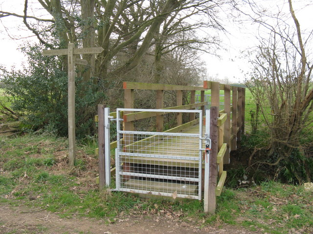 Gated footbridge over small tributary of the River Adur