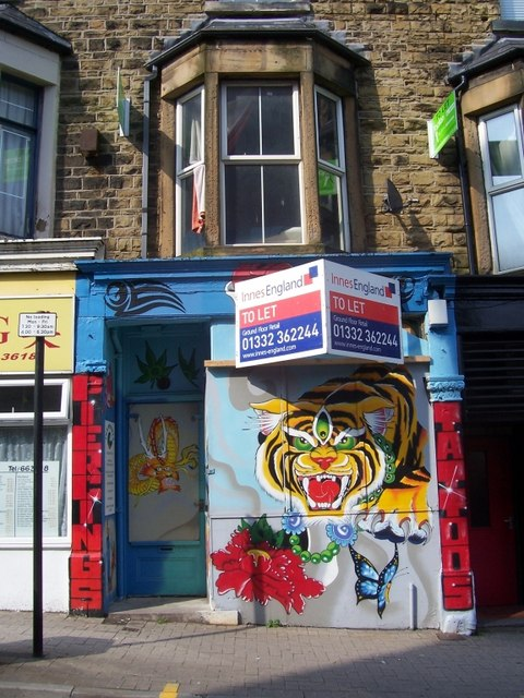 Artwork on the shop-front of the tattoo parlour on Glossop Road.